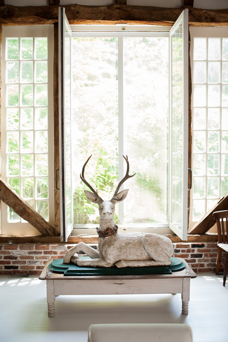 A near life-sized wooden sculpture of a deer at Two Barns, the home of Literary Agent Ed Victor. Bridgehampton, NY