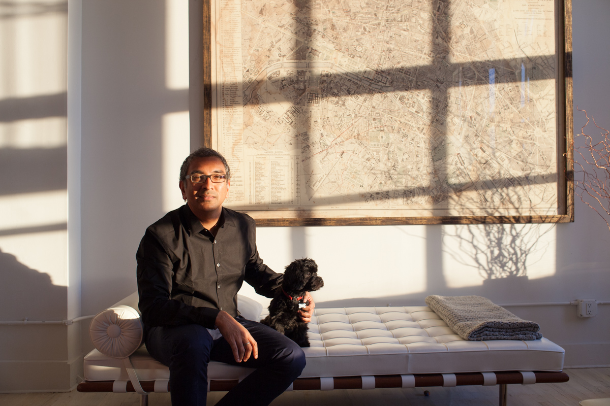 Casual portraits of Columbia University professor & architect Vishaan Chakrabarti at his home in New York City with dog Hero for business magazine