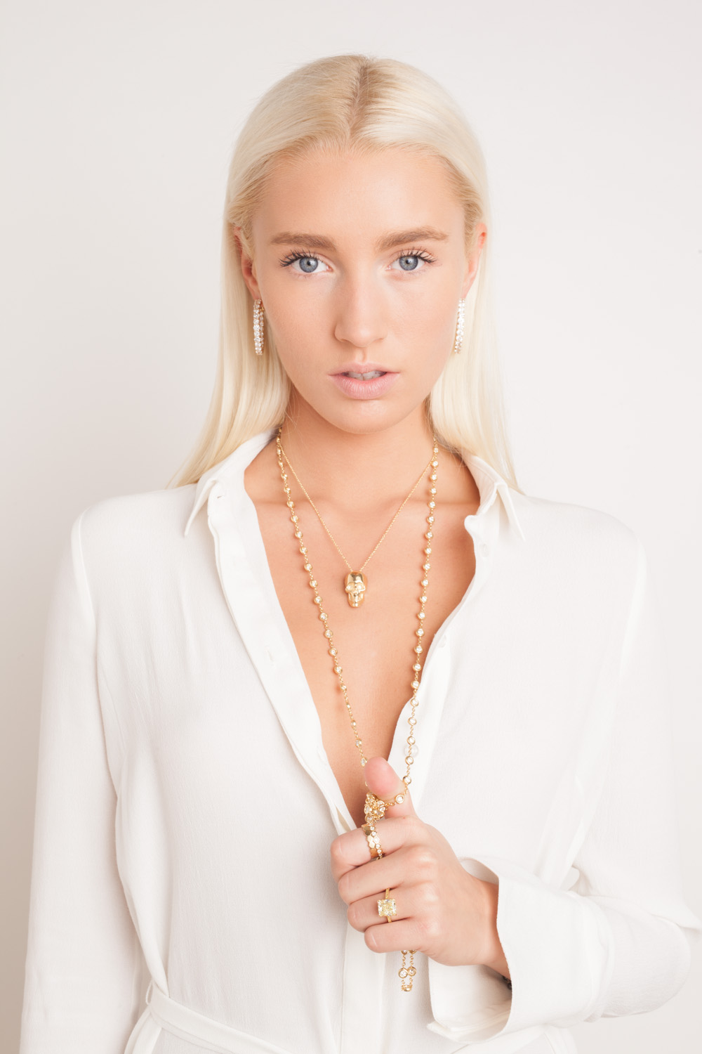 Studio fashion photography NYC jewelry lookbook photographer New York beauty shoot blonde model skull necklace Space 4 Shoots