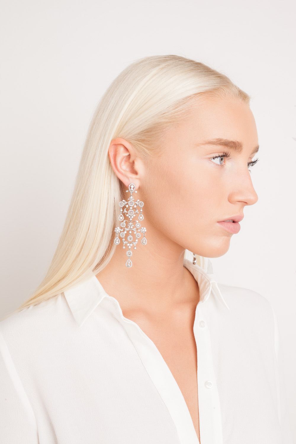Studio fashion photography NYC jewelry lookbook photographer New York beauty shoot blonde model chandelier earrings Space 4 Shoots