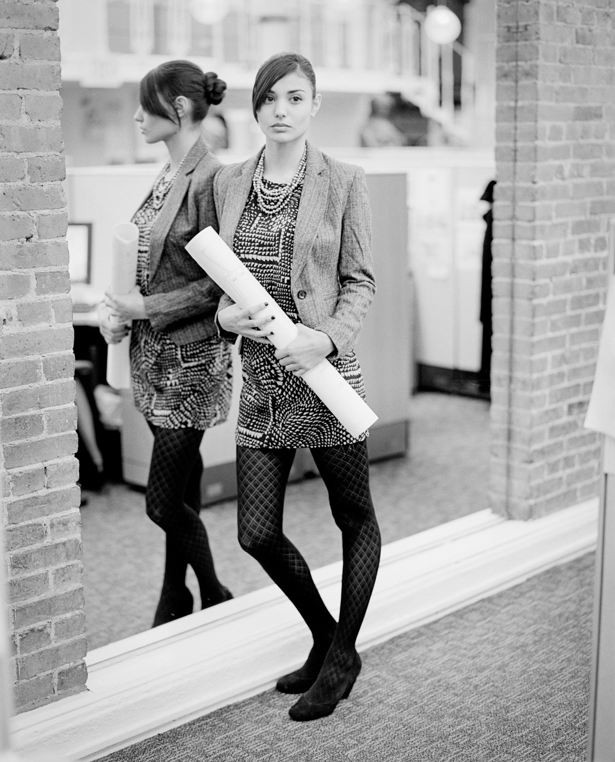 NYC street fashion photography in black and white with model Melina DiMarco in office mirror for French fashion brand Nu New York Union Square