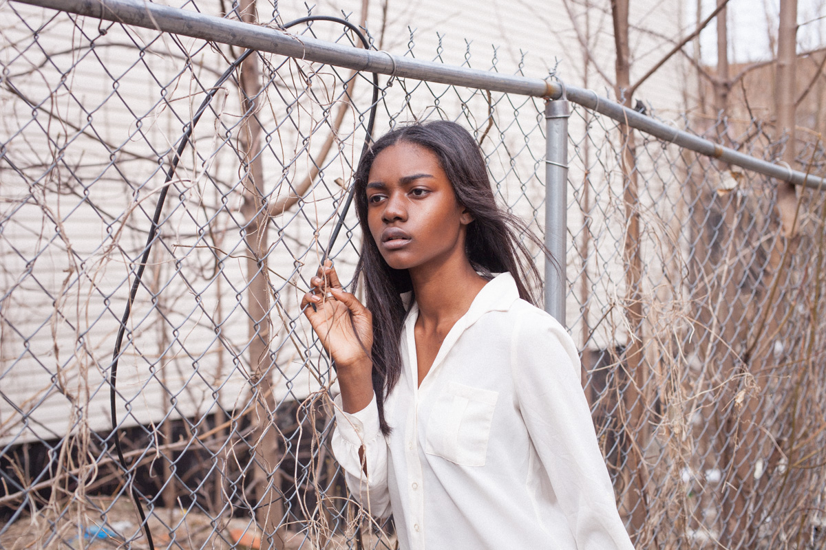 Before Zuri Tibby was Victoria's Secret Pink model, black teen model shot fashion portraits on NYC's gritty urban streets in Bed-Stuy Brooklyn fence
