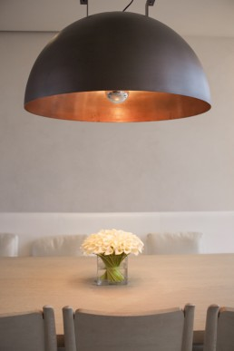 Architecture Photos of Designer Light Fixture & Flowers on Table at Ian Schrager Home