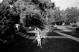 Black and White Picture of Boy in Underwear Screaming & Running Outside Home