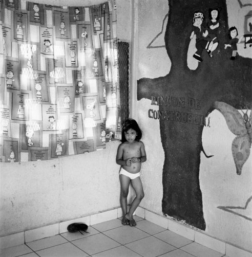 Black and White Picture of School Girl in Underwear in Classroom Corner
