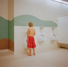 Funny Picture of Young Boy Urinating Alone in Urinal at Pool Bathroom Utah