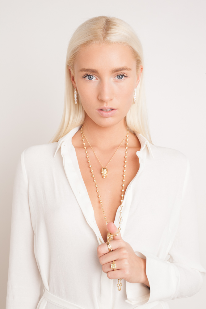 Fashion Photography of Beautiful Blonde Fashion Model in Gold Skull Necklace for Jewelry Lookbook