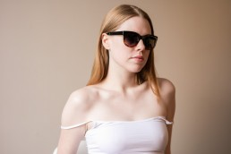 Image of Red-Head Model in Sunglasses & Tanktop for French Fashion Designer NYC