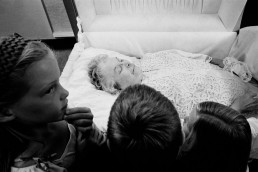 Intimate Black and White Picture of Kids Looking at Grandma's Body in Casket at Funeral
