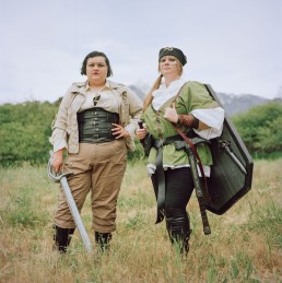 Picture of Friends in Field In Medieval Costume Holding Fake Sword and Shield