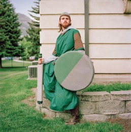 Picture of Man In Medieval Costume Holding Fake Sword and Shield in Park