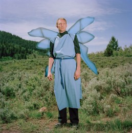 Picture of Middle-Aged Man In Winged Blue Fairy Medieval Standing in Forest Utah