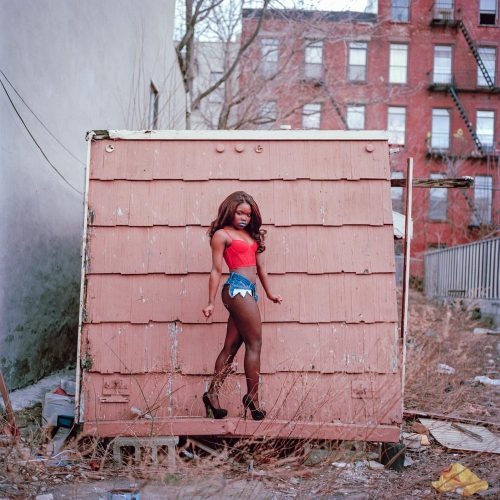 Picture of Petite Black Fashion Model in Red Bustier in Empty Urban Lot NYC