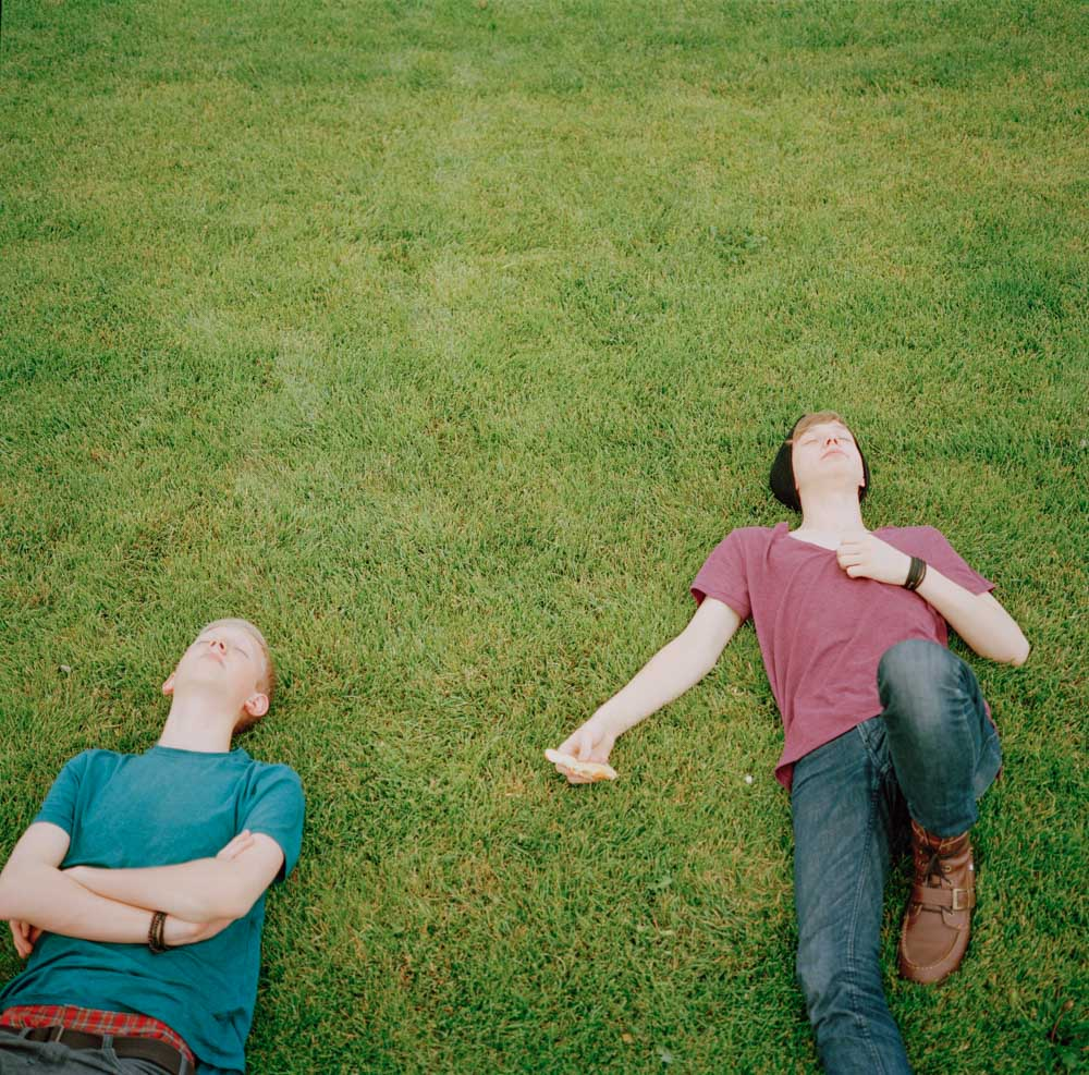 Picture of Teenage Boys Sleeping on Grass After Eating Pizza For Lunch Utah
