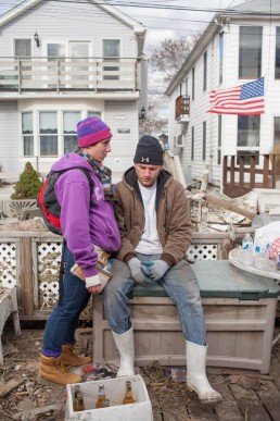 Picture of exhausted friends cleaning up in Breezy Point Queens after Hurricane Sandy