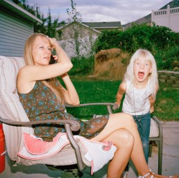 Picture of Angry Blonde Girl Screaming as Mother Talks on Phone in Backyard Utah