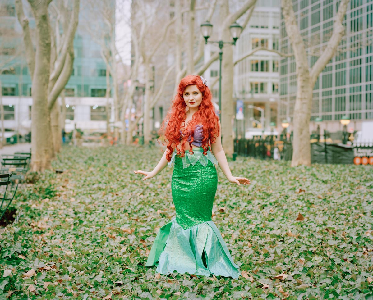 Picture of impersonator of Disney Princess Ariel Little Mermaid standing in Bryant Park NYC