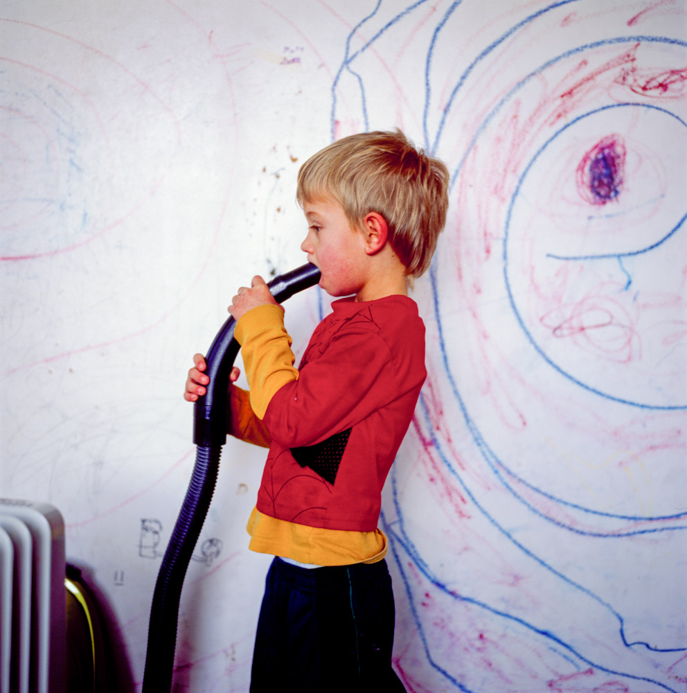 Weird picture of boy with vacuum hose in mouth swirl crayon drawings on walls Utah
