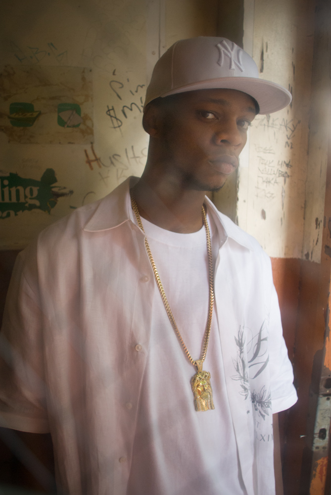 Photo of hip-hop star and rapper Papoose with gold chain in abandoned home Bed-Stuy Brooklyn