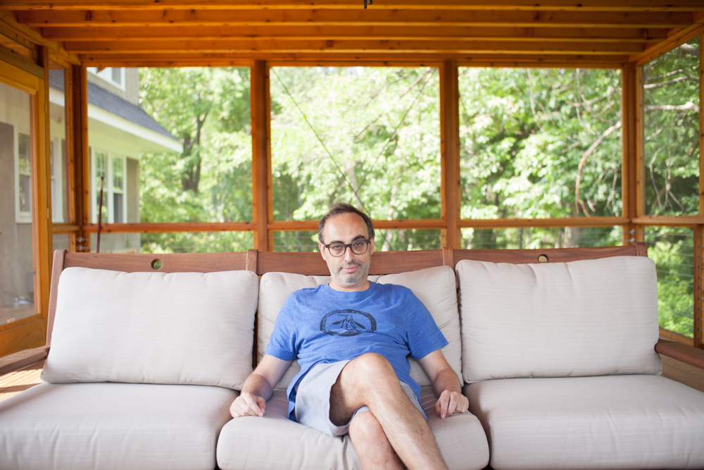 Photo of writer Gary Shteyngart at home on couch for German translation of book LIttle Failure Red Hook NY_
