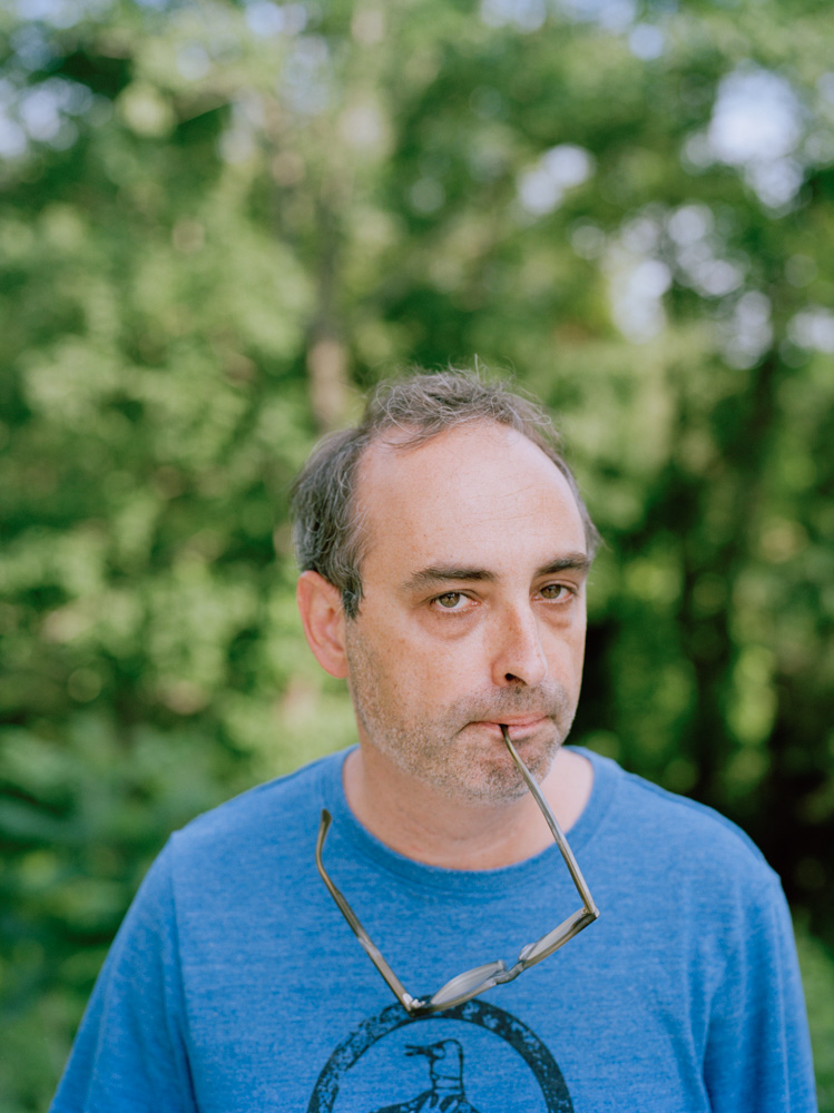 Photo of writer Gary Shteyngart with glasses in mouth German translation book LIttle Failure Red Hook NY