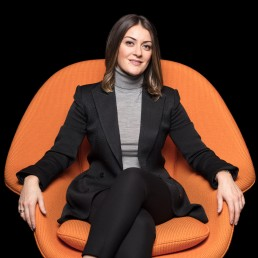 Creative Corporate Headshots Photography - Portrait of NYC Lawyer in Orange Chair