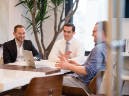 Office Lifestyle - Business & Corporate Lifestyle Photography NYC Business people laughing in meeting