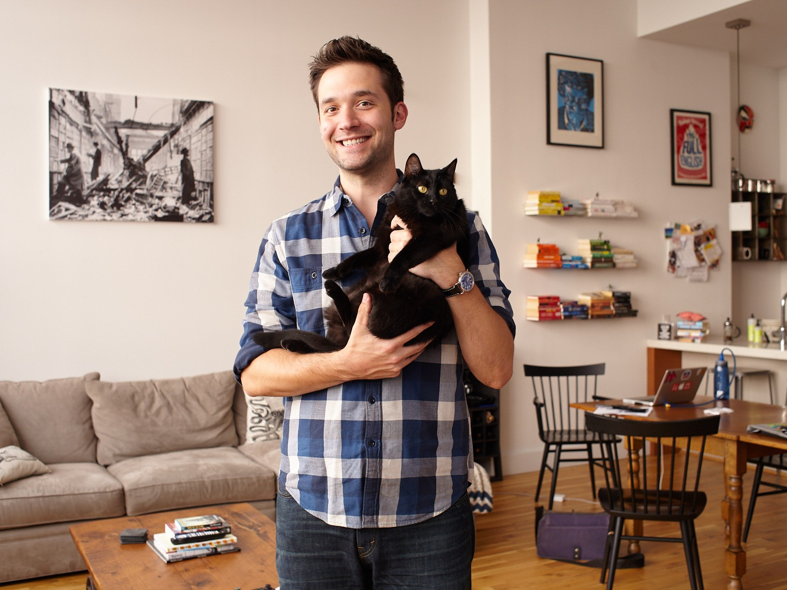 Portraits of Reddit co-founder Alexis Ohanian in Brooklyn NYC apartment holding his kat Karma