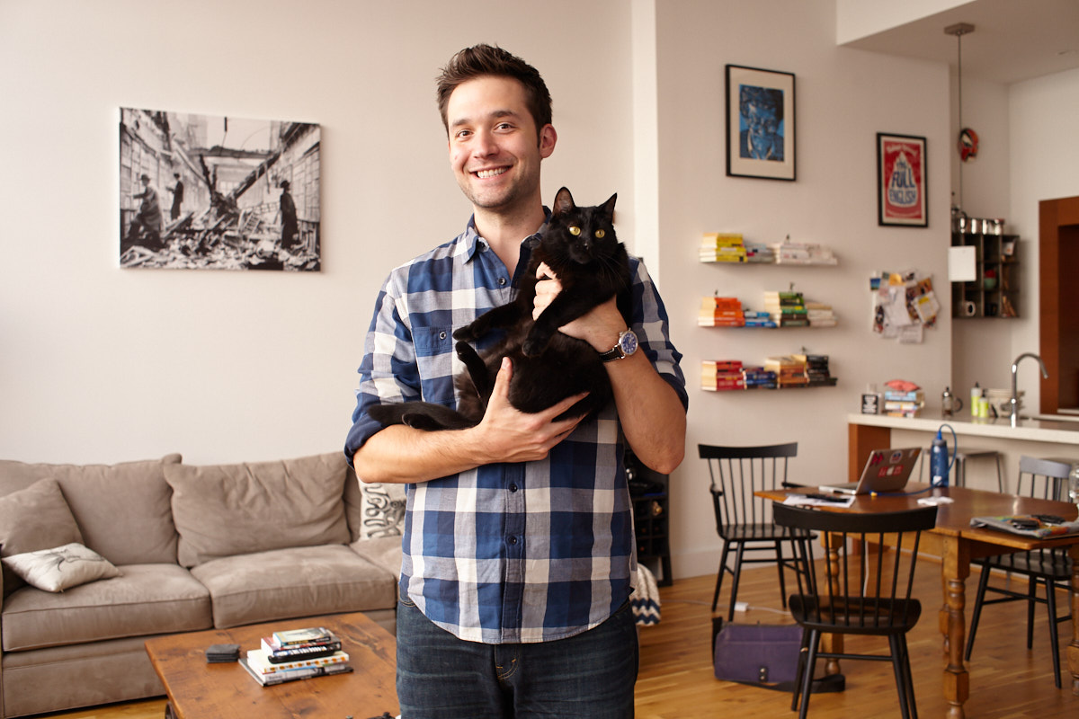 Portrait of Reddit co-founder Alexis Ohanian in his Brooklyn NYC apartment holding his kat Karma
