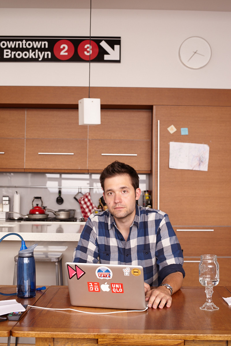 Portrait of Reddit co-founder Alexis Ohanian in his Brooklyn NYC apartment, sitting at the dining room table working