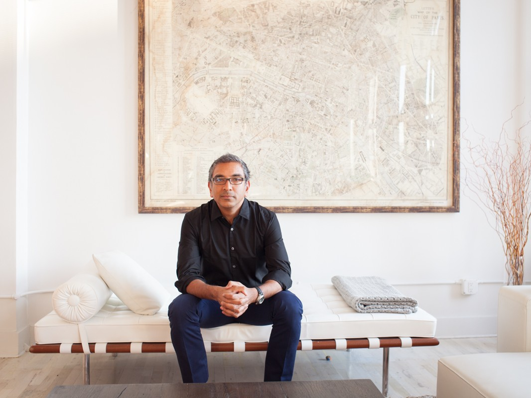 Corporate Portraits CEO Headshots NYC Modern Portraits Photography NYC Portrait of architect, urbanist, author, and Columbia University associate professor Vishaan Chakrabarti at his home in Manhattan. Map of Paris hanging on wall behind. New York, NY