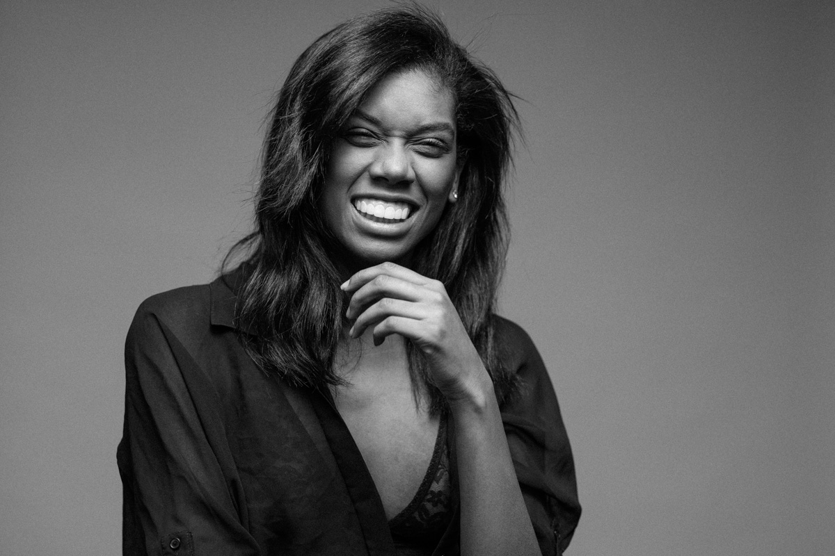 Black and white fashion photography nyc creative portrait fashion photographer new york laughing model