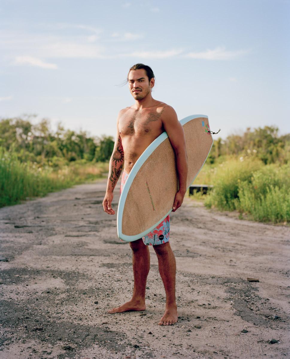 Photography NYC Creative Portrait & Fashion Photographer New York Tattooed Surfer Model at Beach