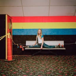 Fine Art Photography Retro Picture of Blonde Teenage Girl Doing Splits at Roller Skating Rink