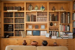 Interiors of home of Elizabeth Barlow Rogers, landscape designer, preservationist and writer of books about Central Park and more. View of study with bookshelves. Upper West Side, Manhattan, NYC