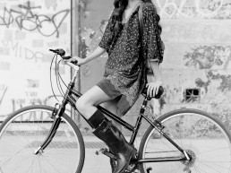 NYC street fashion photography in black and white with model Alexandra Chelaru on bike for French fashion brand Nu New York Union Square