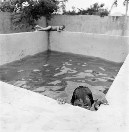 Black and White Picture of Boys Swimming in Concrete Pool Nicaragua
