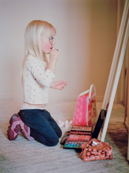 Cute Picture of Small Girl Crimping Eyelashes in Mirror Putting on Make-up