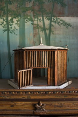 Interior Photos of Wooden Bird Cage Atop Dresser in Room at Joan Davidson's Estate