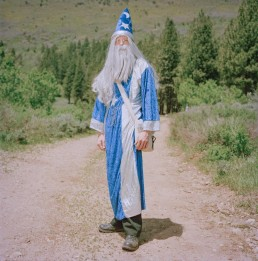 Picture of Man In Medieval Wizard Costume Standing on Path in Woods Utah