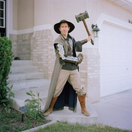 Picture of Man In Steampunk Costume Holding Big Hammer Outside Home