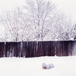 Picture of Small Girl Fallen Down Playing in Deep Snow After Winter Storm Utah
