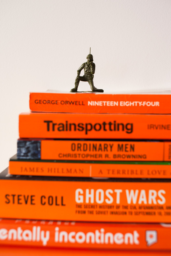Interior Photography Dallas   Stack of Books with Toy Soldier Atop at Home of Reddit's Alexis Ohanian