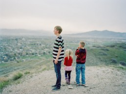 Scenic Picture of Group of Kids Standing Atop a Hill Overlooking Utah Valley Happy Valley