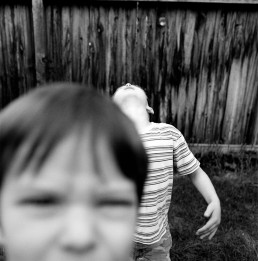 Strange Black and White Picture of Brothers Playing in Backyard Utah