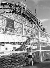 Fine art Photography Black and white picture of girl captivated by The Cyclone Coney Island roller coaster ride