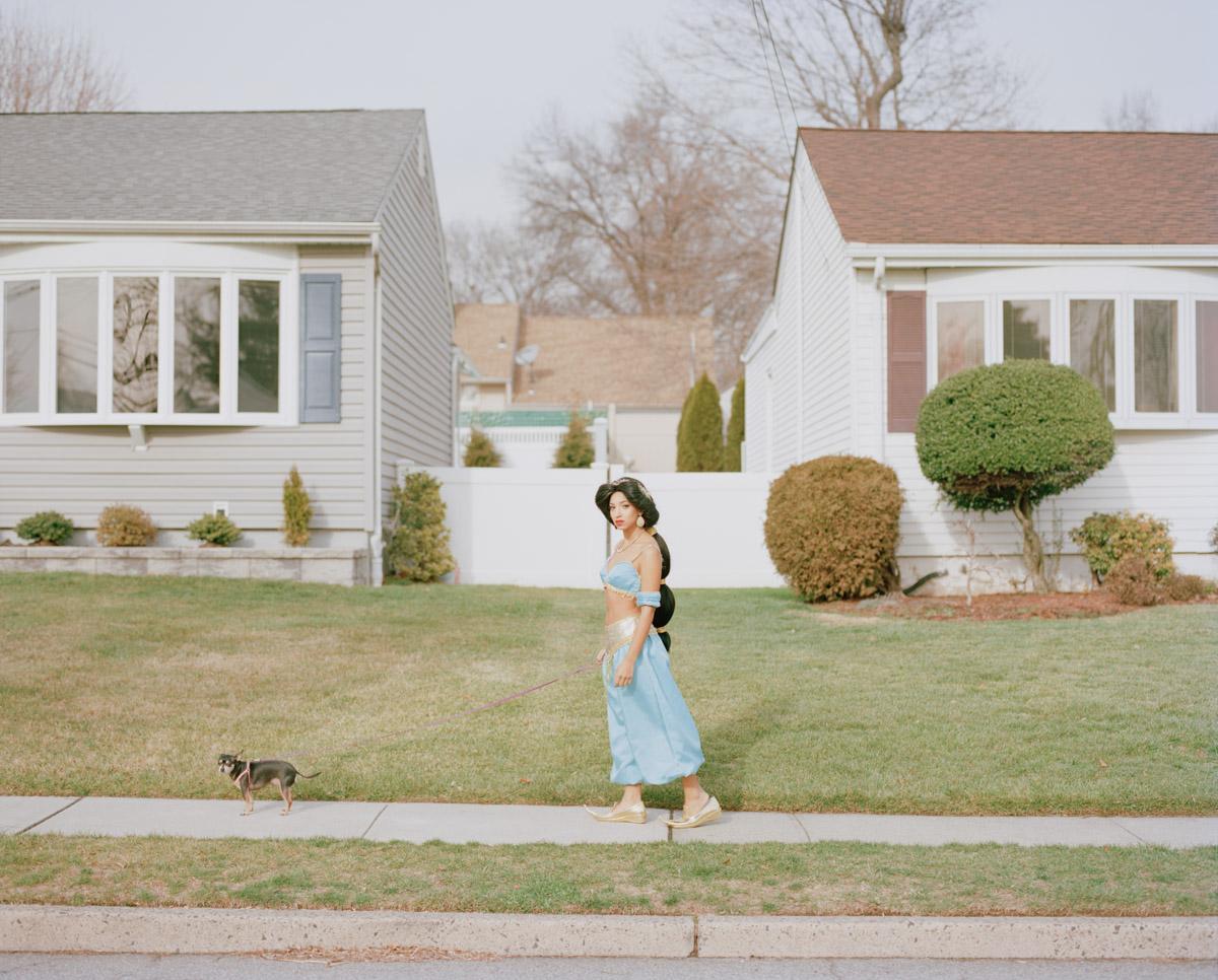 Picture of Latina impersonator of Disney Princess Jasmine walking dog on street NJ