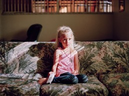 Stunning picture of blonde girl sitting on couch in dramatic morning sunlight Utah