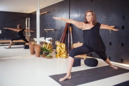 Photo of fashion designer Donna Karan practicing Yoga in her home studio NYC