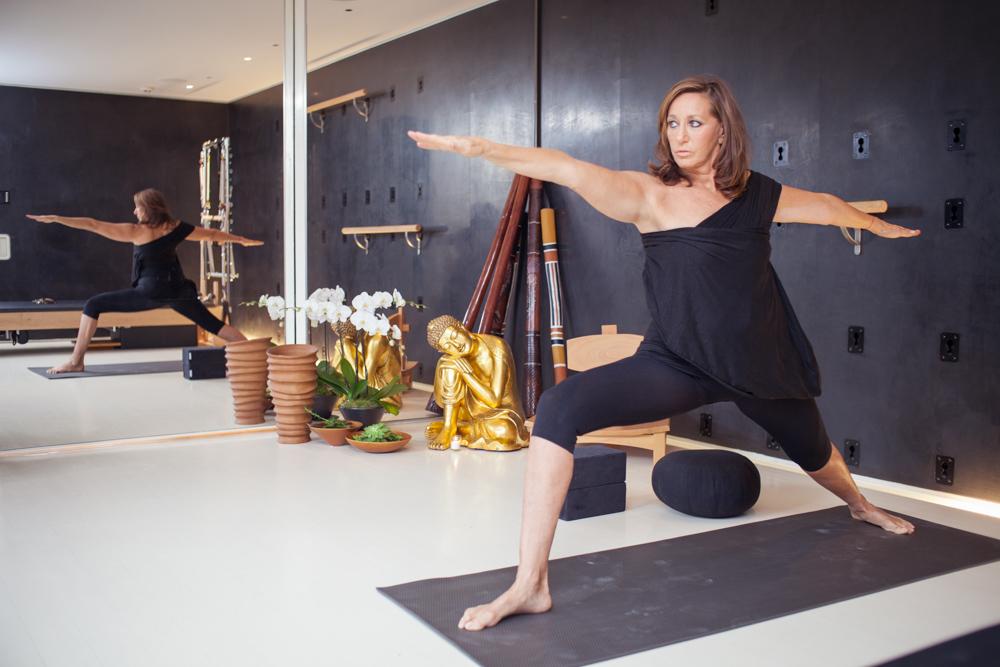 Photo of fashion designer Donna Karan practicing Yoga in her home studio NYC